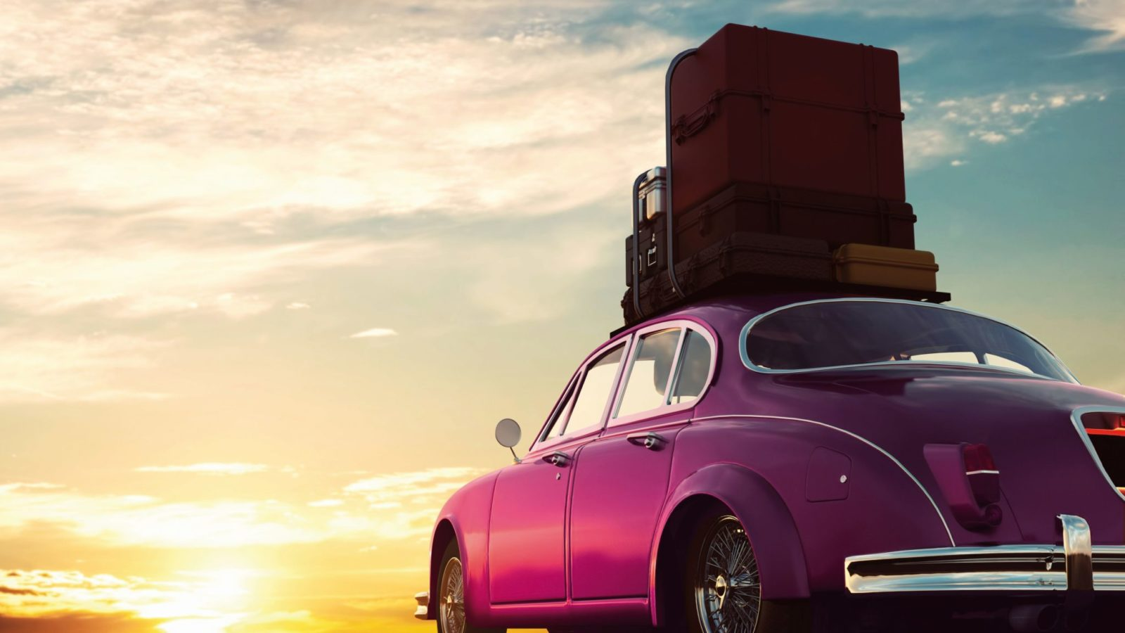 Retro red car with luggage on roof rack at sunset. Travel, vacat